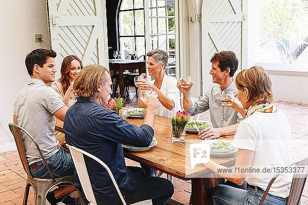 Friends and family having lunch in restaurant  Cape Town  South Africa