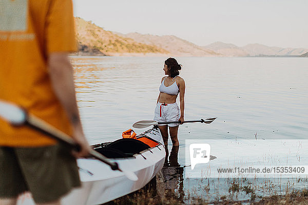 Woman beside kayak in lake  Kaweah  California  United States