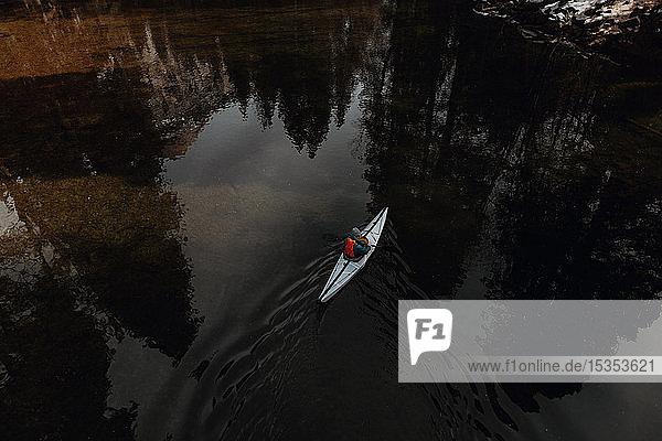 Man kayaking in lake  Yosemite Village  California  United States