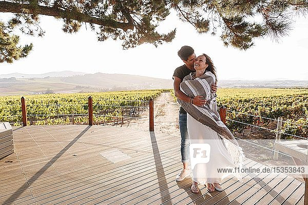 Couple hugging in vineyard  Cape Town  South Africa