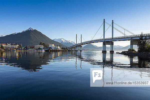 John O'Connell bridge reflected in the Sitka harbour and the town of Sitka in winter with Mount Versovia in the background; Sitka  Alaska  United States of America
