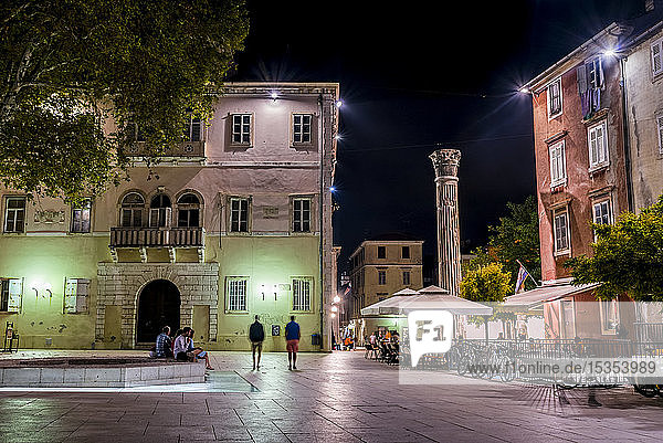 The Deputy's Palace and column at the Five Wells Square at night; Zadar  Croatia