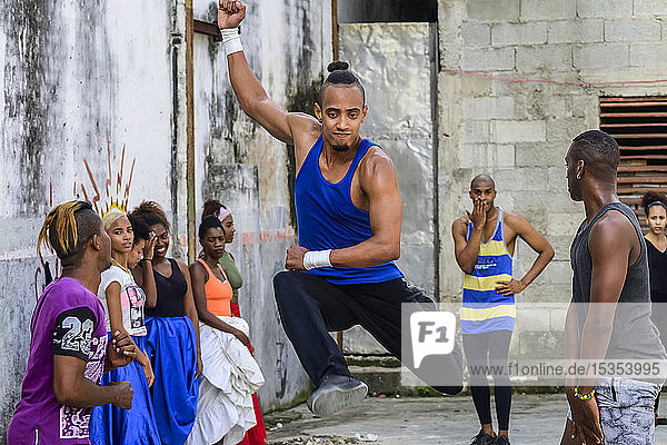 Young Cuban men dancing in an old concrete building with graffiti on the walls; Havana  Cuba