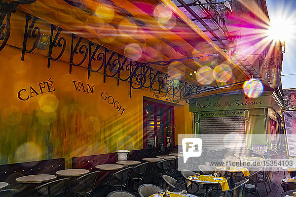 Cafe Van Gogh  with a sunburst and flare over the outdoor patio seating; Arles  Provence Alpes Cote D'Azur  France