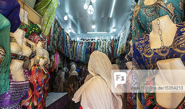 Eritrean woman at a clothing shop in the Mercato of the indigenous people; Asmara  Central Region  Eritrea