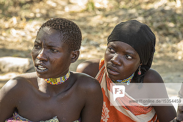 Close-up of two young Hadzabe women wearing colourful beaded jewelry near Lake Eyasi; Tanzania