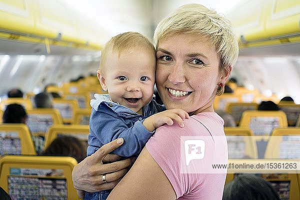 Mother with her six months old baby boy in the airplane  Spain  Europe