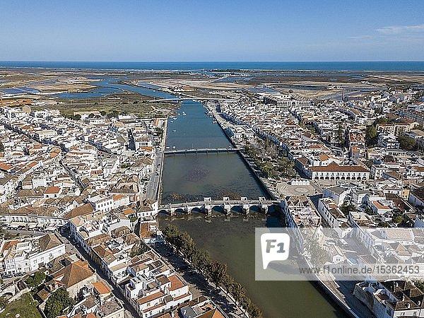 City view with roman bridge over Gilao river in old fishermen's town Tavira  drone shot  Algarve  Portugal  Europe