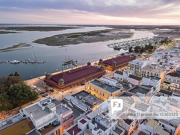 City view with two market buildings and and river Ria Formosa in the evening  Ria Formosa Natural Park  Olhao  Algarve  Portugal  Europe