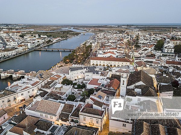 City view with roman bridge over Gilao river in old fishermen's town in the evening light,  Tavira,  drone shot,  Algarve,  Portugal,  Europe, City view with roman bridge over Gilao river in old fishermen's town in the evening light,  Tavira,  drone shot,  Algarve,  Portugal,  Europe