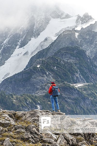 Female hiker off Mt. Shuksan with snow and glacier  Mt. Baker-Snoqualmie National Forest  Washington  USA  North America