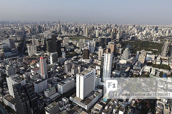 View from Maha Nakhon Tower  314m  city panorama  Pathumwan and Watthana district  Lumphini Park  Bangkok  Thailand  Asia