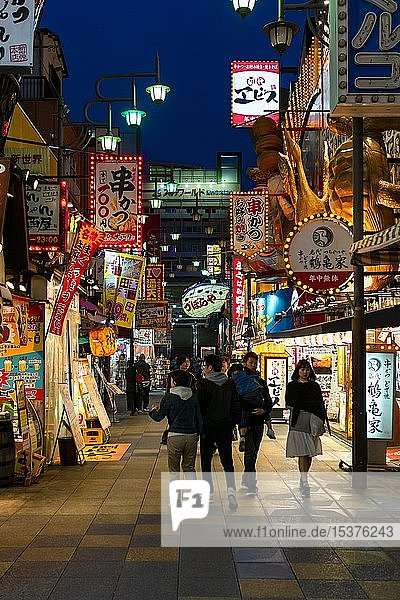 Many colorful neon signs in a pedestrian zone with shops and restaurants  shopping center  night scene  Shinsekai  Osaka  Japan  Asia