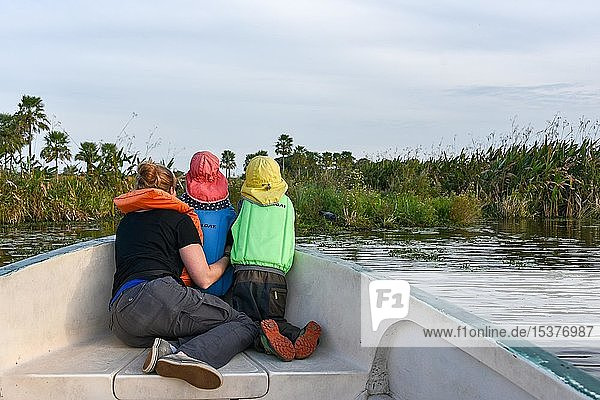 Mother with two small children with life jackets watching animals in a boat  National Park Esteros del Iberá  Province Corrientes  Argentina  South America