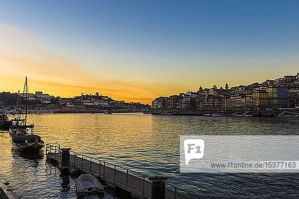 Sunset over Douro river with Rabelo boat and Ribeira district  Porto  Portugal  Europe