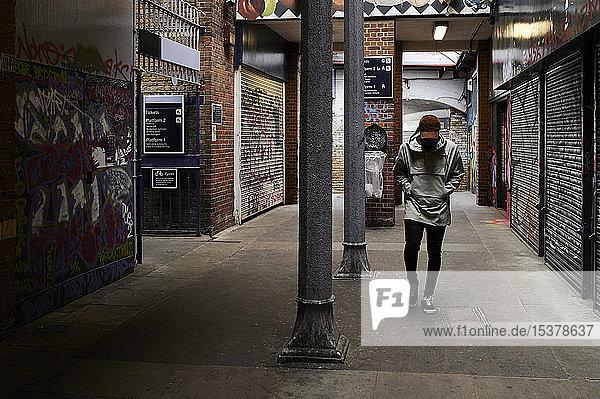 Man walking in an underpass  London  UK