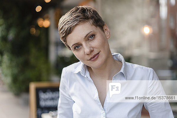 Portrait of a confident woman at a cafe