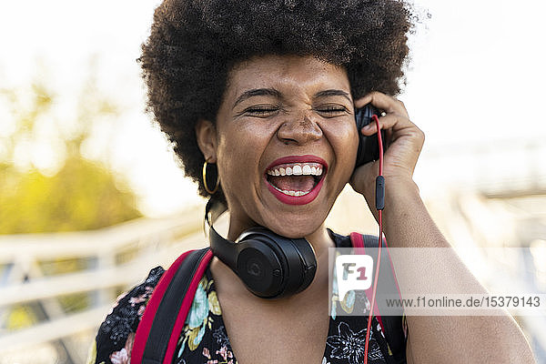 Laughing Afro-American woman with headphones