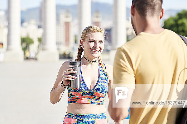 Happy woman with man finishing workout outdoors in the city