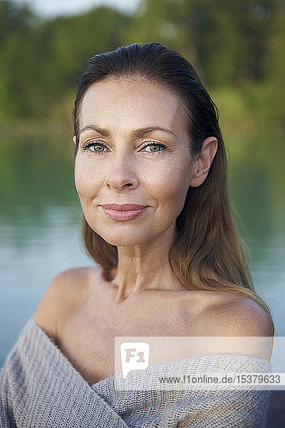 Portrait of mature woman at a lake