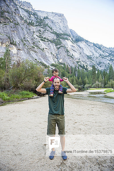 Portrait of happy father carrying little daughter on his shoulders  Yosemite National Park  California  USA