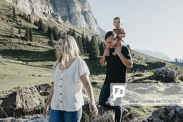 Happy family with little son on a hiking trip in the mountains  Schwaegalp  Nesslau  Switzerland