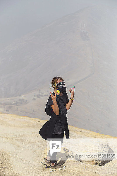 Young woman with espirator mask at Ijen volcano  Java  Indonesia