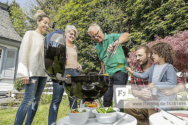 Extended family having a barbecue in garden