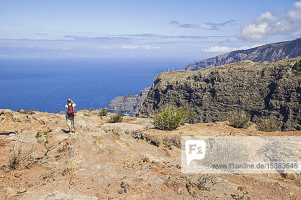 Hiker at the coast enjoying the view  Agulo  La Gomera  Canary Islands  Spain