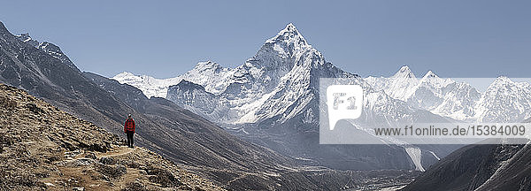Young woman hiking in Sagarmatha National Park  Everest Base Camp trek  Nepal