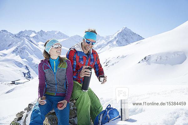 Happy youple of ski tourers having a break in the mountains  Kuehtai  Tyrol  Austria