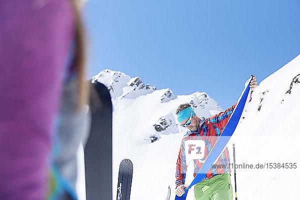 Ski tourer removing pelt from ski in the mountains  Kuehtai  Tyrol  Austria