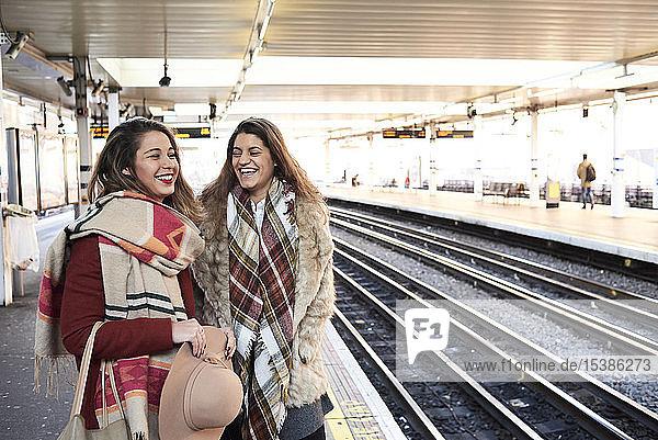 UK  London  two happy women at underground station platform