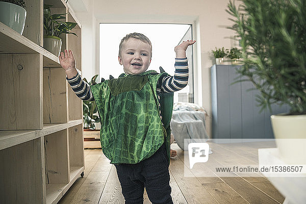 Happy boy in a costume at home