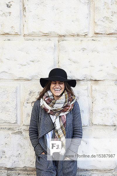 Portrait of a happy woman wearing a floppy hat