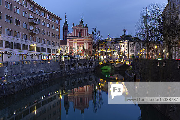 Slovenia  Ljubljana  view to city centre with Franciscan Church and lighted Triple Bridge