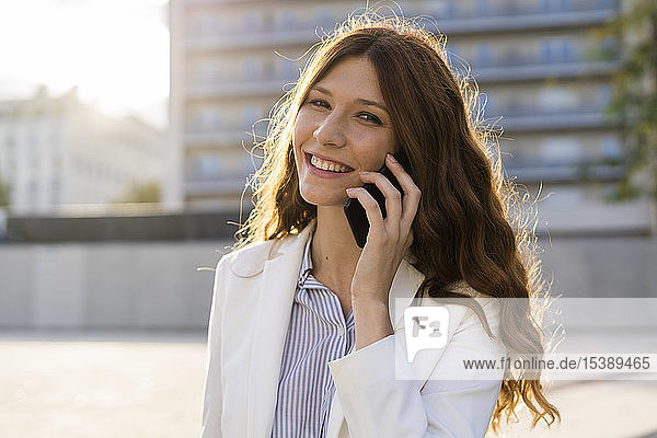 Young businesswoman in the city  talking on the phone