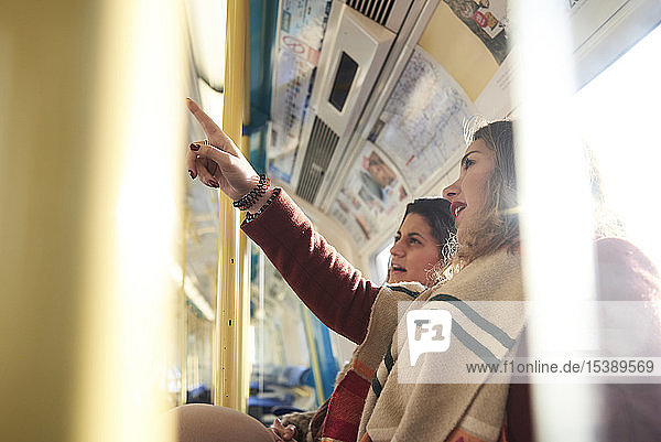 UK  London  two women in underground train checking the connection