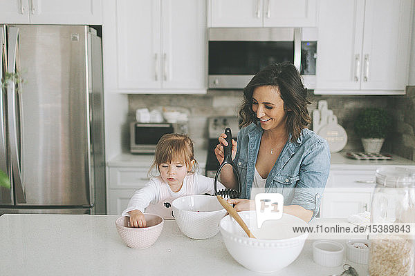 Mother and daughter making a cake together