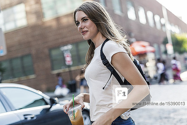 Young woman exploring New York City  crossing street