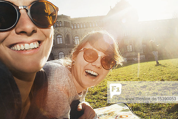 Portrait of two women laughing in park