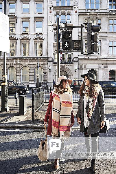 UK  London  two women in the city crossing a street