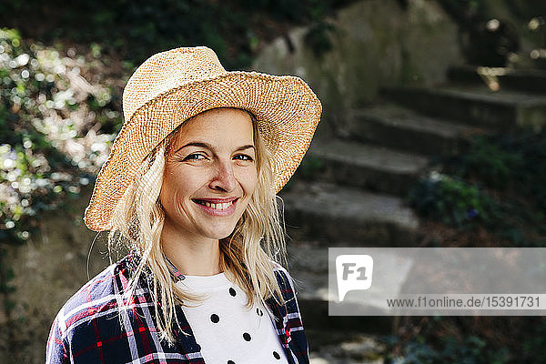 Young blond woman with straw hat
