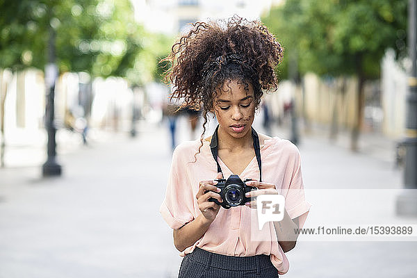 Young woman looking at camera in the city
