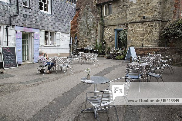 Cafe Table and Chairs with Florist  Petworth  England  UK.
