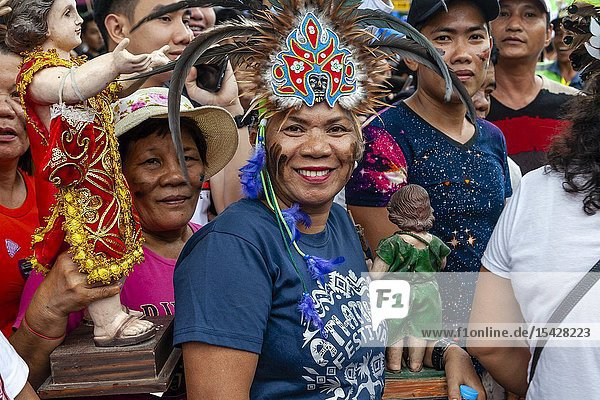 Kalibo  The Philippines. 20th January 2019. Thousands of Philippinos take part in a religious street procession honouring Santo Nino (Holy Child) during the last day of the annual Ati-Atihan festival in the city of Kalibo  Panay Island  The Philippines. Credit: Grant Rooney/Alamy Live News.