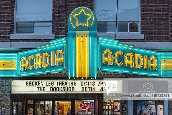 Canada  Nova Scotia  Annapolis Valley  Wolfville  Acadia Theater  neon marquee  dusk.