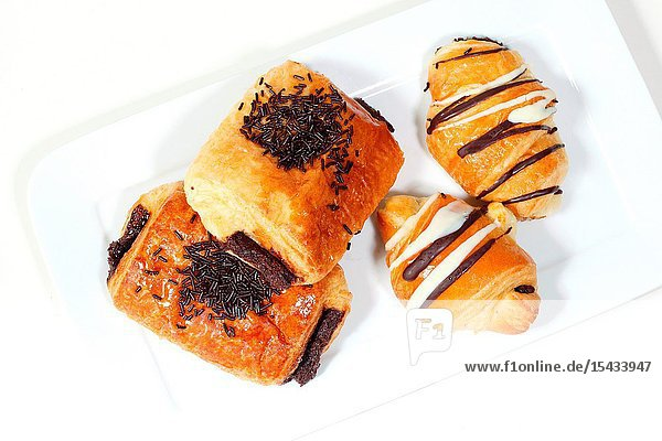 Chocolate buns on a plate with white background