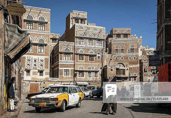 Street scene and local heritage architecture buildings in old town of sanaa yemen.