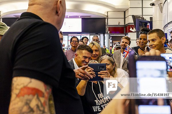 The Right Wing Activist Tommy Robinson Poses For Selfies With His Supporters Inside City Thameslink Station After His Contempt Of Court Charge At The Old Bailey was Adjourned  London  UK.